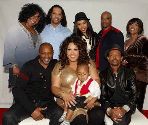 "Pictured is Kym Whitley, 2-year old Joshua, Rodney Van Johnson(L), Wendell James bottom right and, ""The Village""  Photo credit:  OWN"